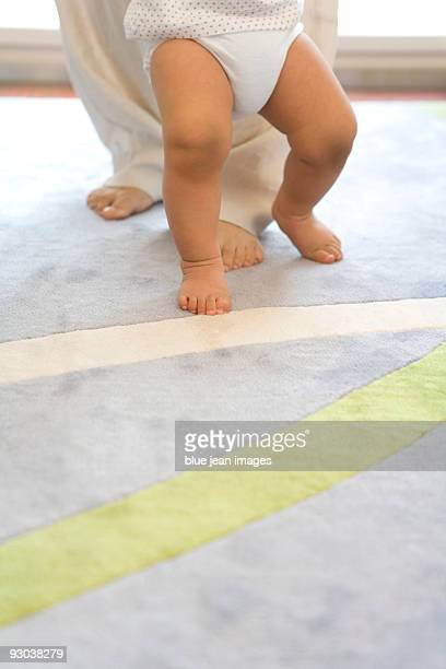 infant legs on carpet - first occurrence stock pictures, royalty-free photos & images