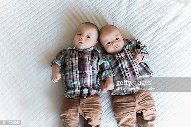 Infant Twin Babies Play Together