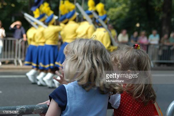 infant watching cheerleaders near the road - parade stock pictures, royalty-free photos & images