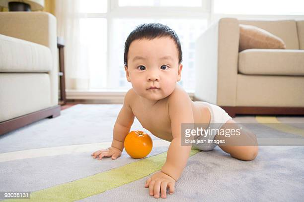 Infant with fruit
