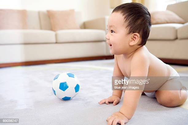 infant with soccer ball - one baby boy only stock pictures, royalty-free photos & images