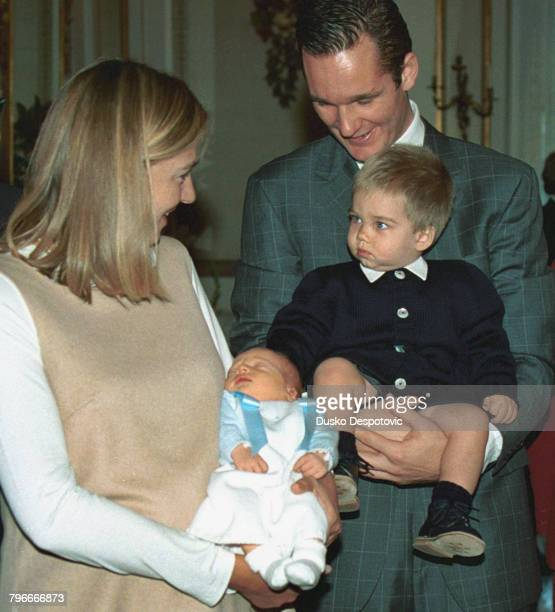 Infanta Christina baby Pablo Nicolas and Juan aged one in the arms of his father Inaki Urdangarin
