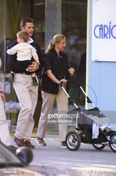 Infanta Cristina with her husband Inaki Urdangarin walk in the streets of Palma di Majorca with their children Juan Valentin and Pablo Nicolas