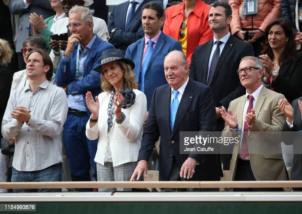 Infanta Elena Duchess of Lugo and her father Juan Carlos I of Spain cheer for Rafael Nadal of Spain during the men's final on day 15 of the 2019...