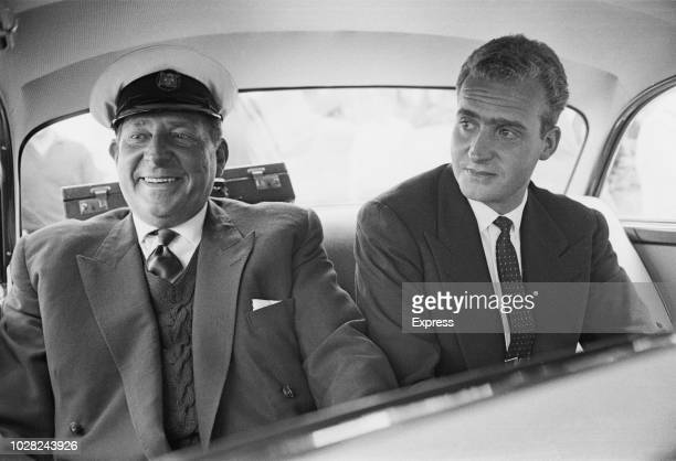 Infante Juan, Count of Barcelona pictured on left with his son Prince Juan Carlos de Borbon, heir to the Spanish throne, in the rear seat of a car at...