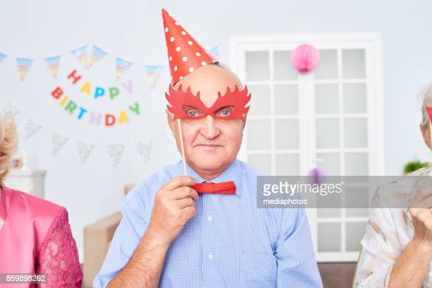 infantile senior man - funny birthday stock photos and pictures