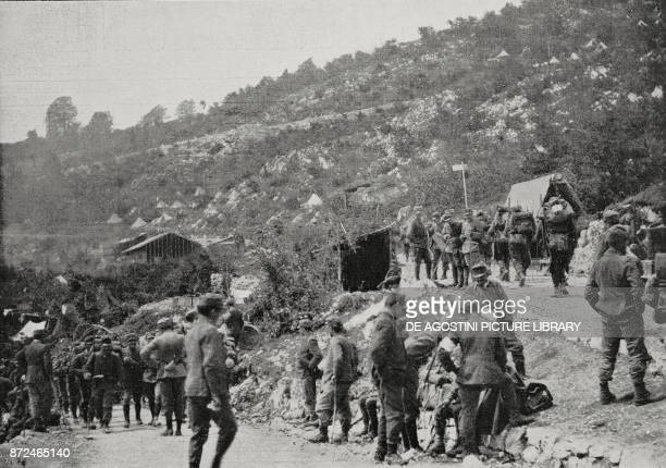 Infantry advancing in a dead corner amongst rescue posts while on the crest sharpnell bullets are raining World War I from L'Illustrazione Italiana...