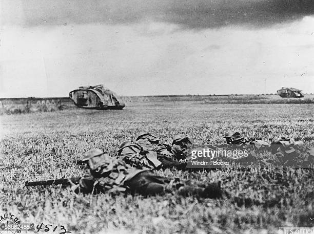 Infantry behind tanks One Platoon of infantry follows up each tank 107th Regiment Infantry 27th Division near Beauquesnes Somme 13th September 1918