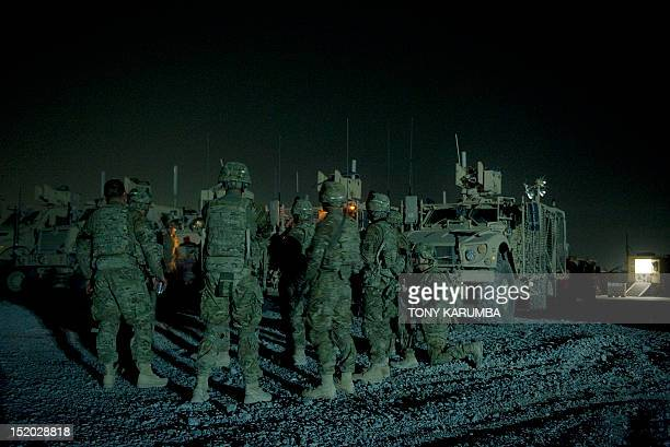 Infantry men from the 1st platoon Delta coy attend a briefing prior to embarking on a night patrol from Lindsey foward operating base on September 15...