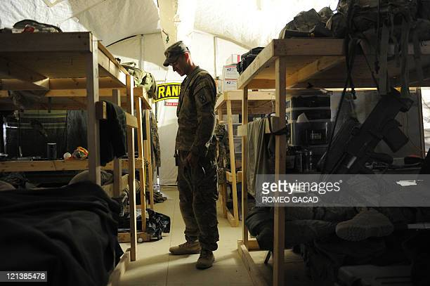US infantry officer 2nd Lieutenant Dylan Potter of Delta Company 287 Infantry Battalion 3rd Brigade Combat Team checks on his men in Delta Company...