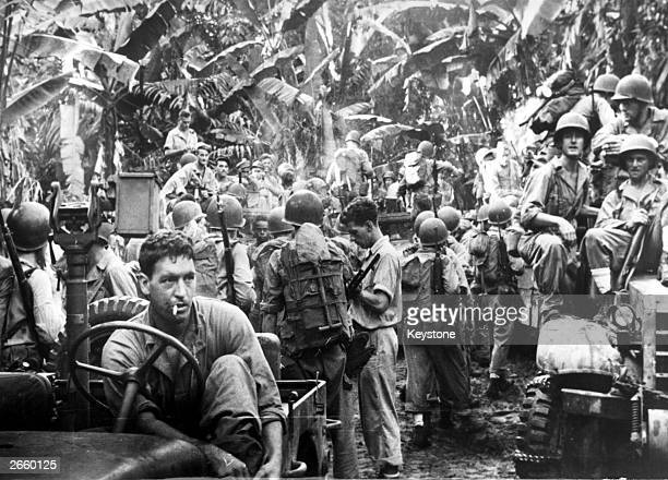 Infantry on Bougainville Island preparing to set out on a reconnaissance patrol against the Japanese during war in the Pacific.