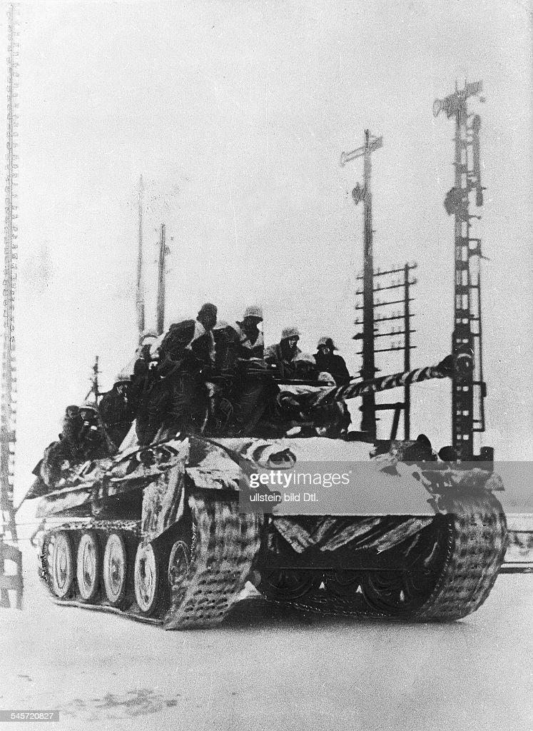 BRESLAU  Infantry riding on top of a German Panzer V tanks