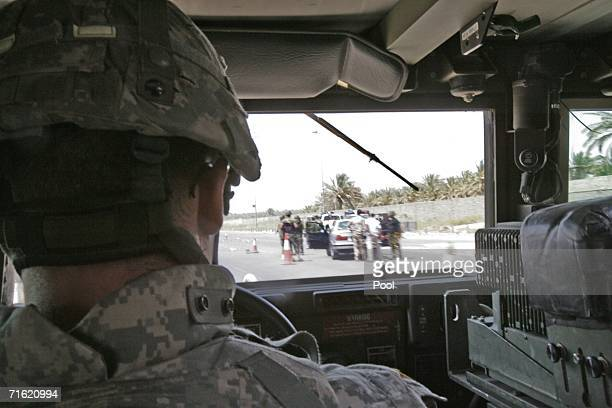 A US Infantry soldier halts ahead of a checkpoint during a patrol in Baghdad's Doura street after Iraqi BG Abdel Karim Abdel Rahman Yussef commander...