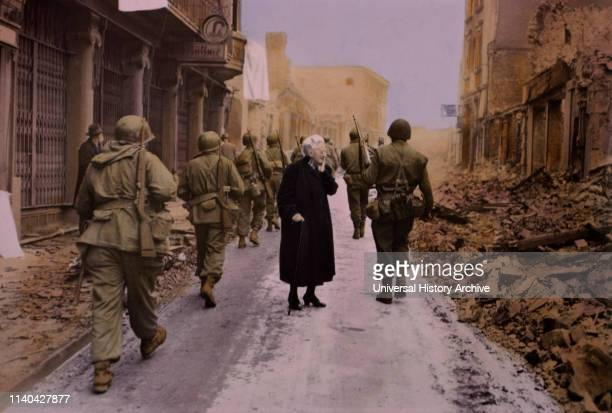 Infantry Troops Marching Through Town Elderly Woman Looking at Demolished Buildings Central Europe Campaign Western Allied Invasion of Germany 1945