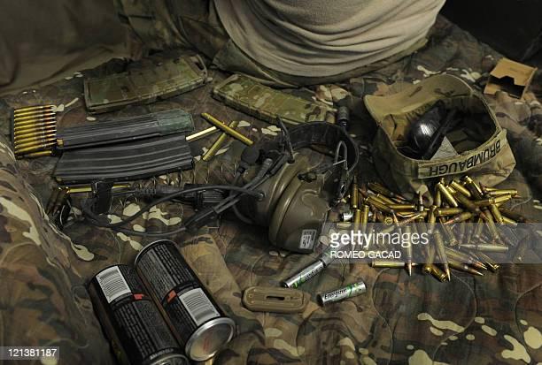 A US infantryman of Delta Company 287 Infantry Battalion 3rd Brigade Combat Team prepares his ammunition in the Delta Company barracks at combat...