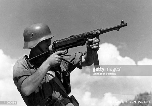 Infantryman of the Hungarian army taking aim with a 'Maschinenpistole 40' August 1941