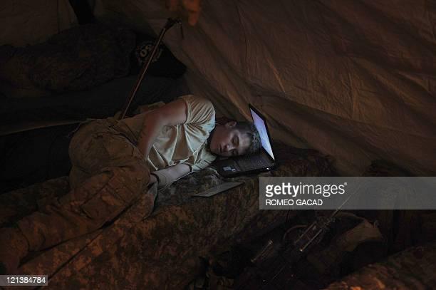 US Infantryman Private Freymond Tyler Of Delta Company 287 Infantry Battalion 3rd Brigade Combat Team Sleeps