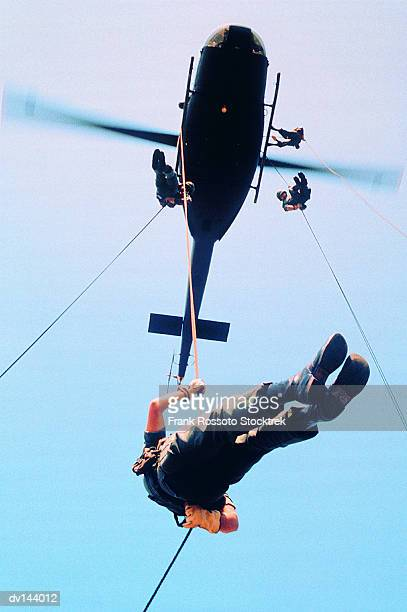 Infantryman rappelling from UH-1 Iroquois Helicopter