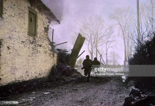Infantrymen Advancing under Enemy Shell Fire ArdennesAlsace Campaign Battle of the Bulge 1945