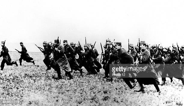 Infantrymen charging with fixed bayonets September 1914 France World War I