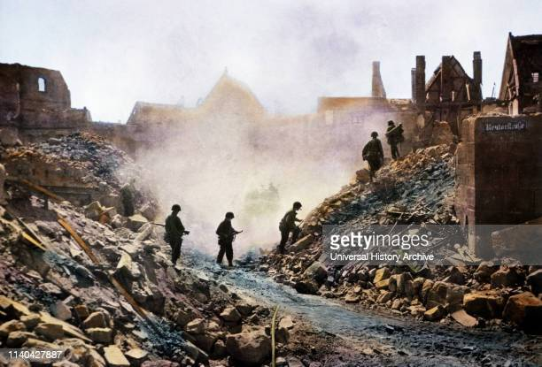 Infantrymen Climbing over Rubble as they Clear Snipers Nuremberg Germany Central Europe Campaign Western Allied Invasion of Germany 1945