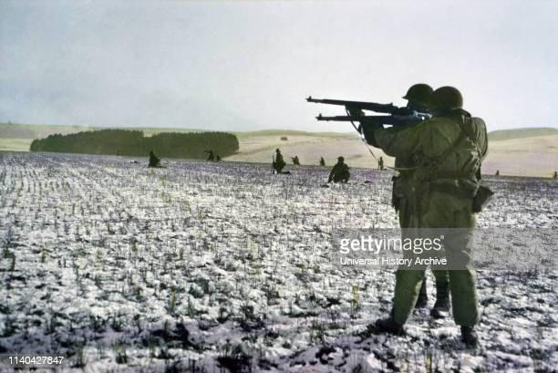 Infantrymen Fire at German Troops in Advance to Relieve Surrounded Paratroopers Bastogne Belgium ArdennesAlsace Campaign Battle of the Bulge December...