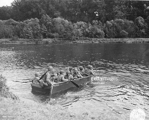 Infantrymen of the 5th Inf Div in combat boats are shown paddling across the Moselle River during advance toward Metz, France, September 8, 1944....