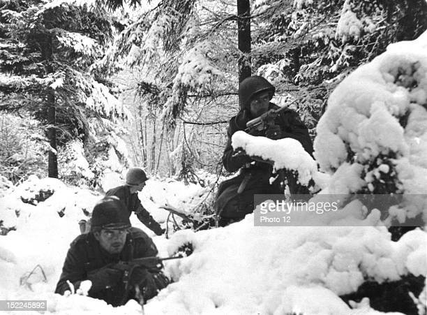 Infantrymen of the 7th US Infantry Division dig in for an attack in snowdrifts near Amonies January 4 1945 during the 'Battle of the Bulge'