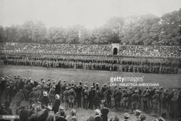 Infantrymen of the Cuneo Brigade and bersaglieri of the 12th battalion review in the Arena Civica in Milan among enthusiastic citizens from the...