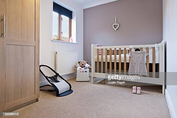 infant's nursery - empty crib stock photos and pictures