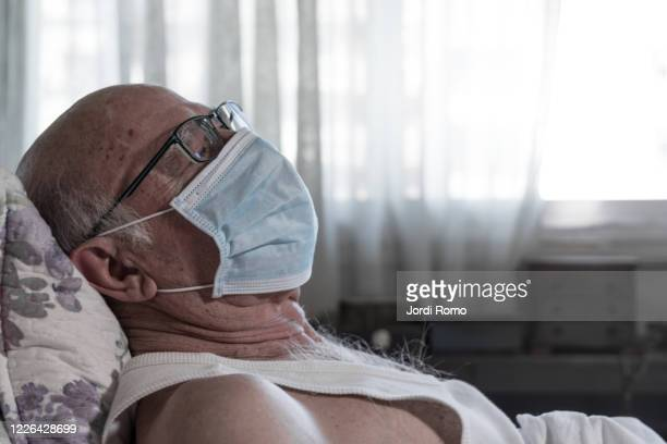 infected old man in the bed - euthanasia stock pictures, royalty-free photos & images