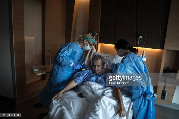 Infectious Disease specialist Prof Dr Sesin Kocagoz checks on a patient recovering from the COVID19 virus in the COVID19 inpatient ward at the...