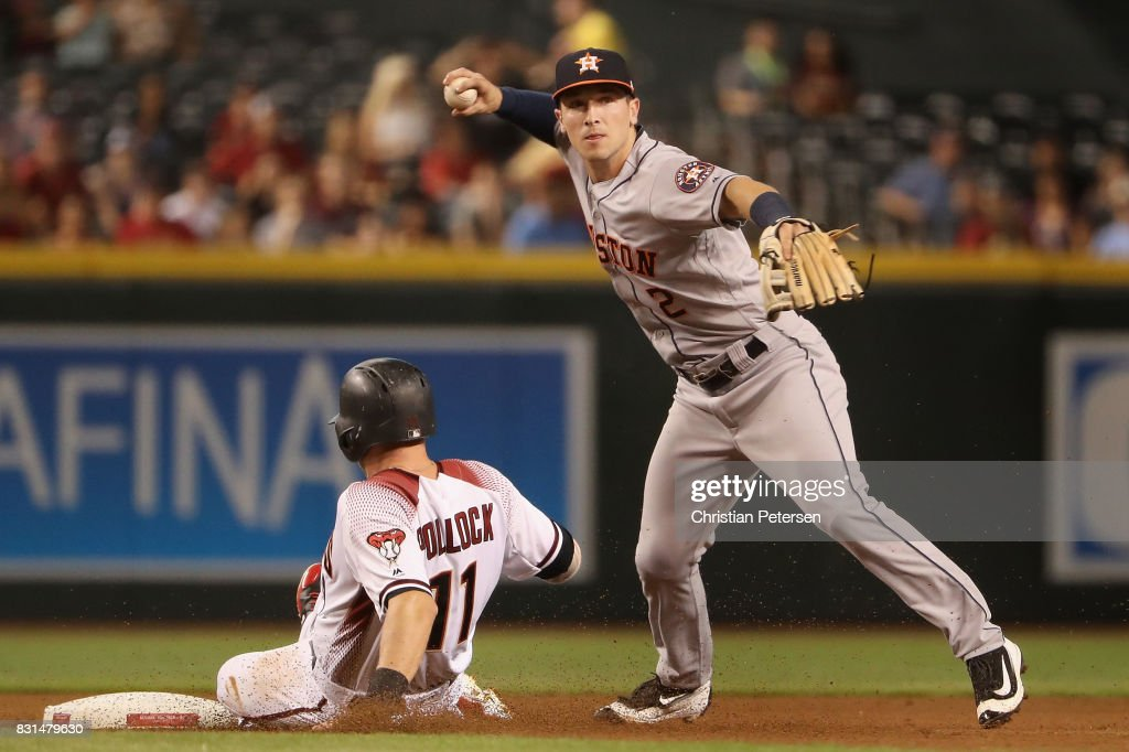 Infeilder Alex Bregman #2 of the Houston Astros throws over the sliding A.J. Pollock #11 of the Arizona Diamondbacks to compete a double play during the first inning of the MLB game at Chase Field on August 14, 2017 in Phoenix, Arizona.