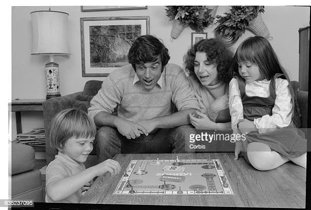Infertility expert Bonnie Gradstein plays Sorry a board game with her adopted son David on the left her husband Marc and their daughter Diana on the...