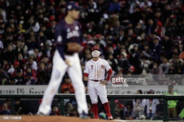 Infiedler Eugenio Suarez of the Cincinnati Reds blow a bubble in the bottom of 7th inning during the game four between Japan and MLB All Stars at...