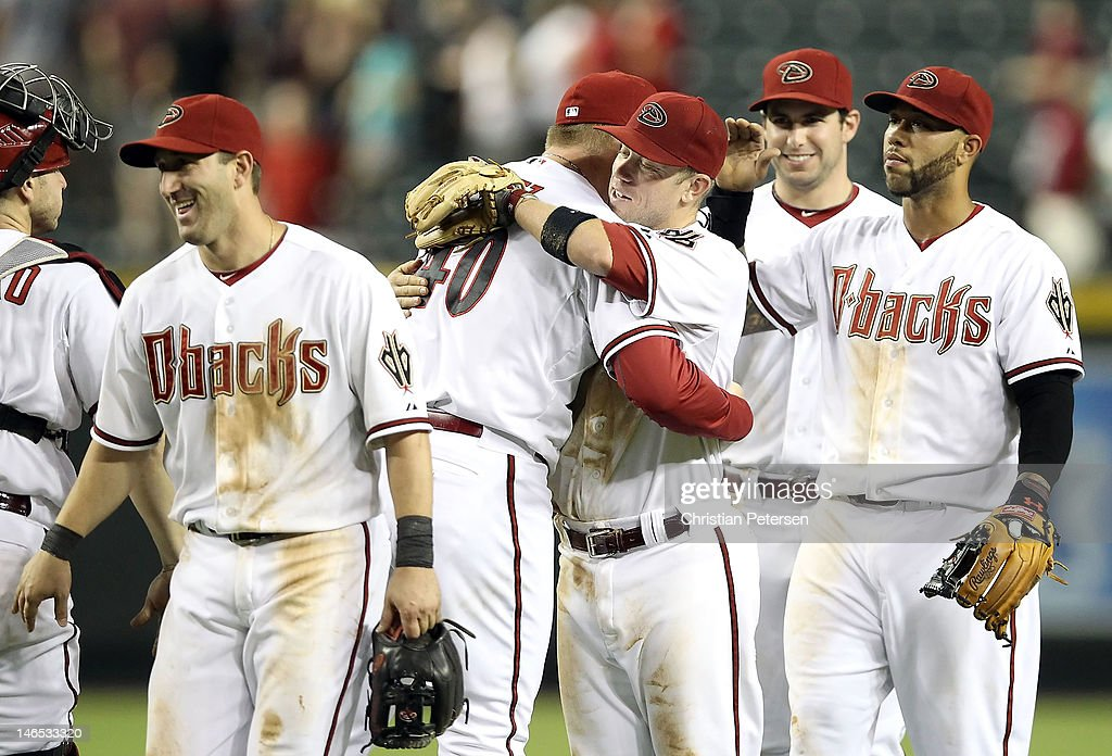 Infielder Aaron Hill #2 of the Arizona Diamondbacks hugs relief pitcher J.J. Putz #40 after defeating the Seattle Mariners in the interleague MLB game at Chase Field on June 18, 2012 in Phoenix, Arizona. Aaron Hill hit for the cycle. The Diamondbacks defeated the Mariners 7-1.