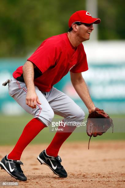 Infielder Adam Rosales of the Cincinnati Reds prepares for a play against the Boston Red Sox during the game on March 5 2008 at City of Palms Park in...