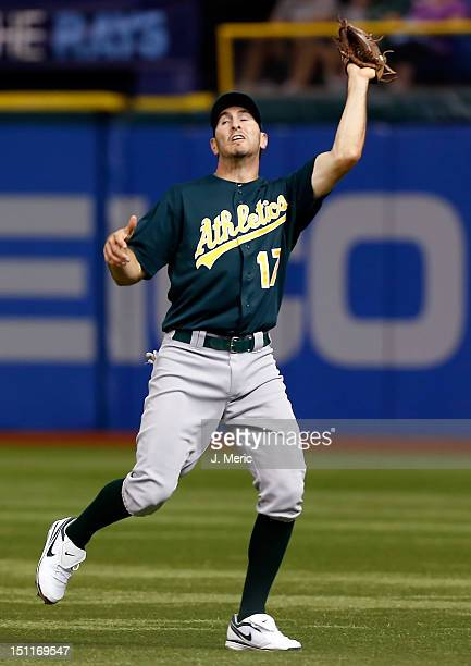 Infielder Adam Rosales of the Oakland Athletics catches a fly ball against the Tampa Bay Rays during the game at Tropicana Field on August 24 2012 in...