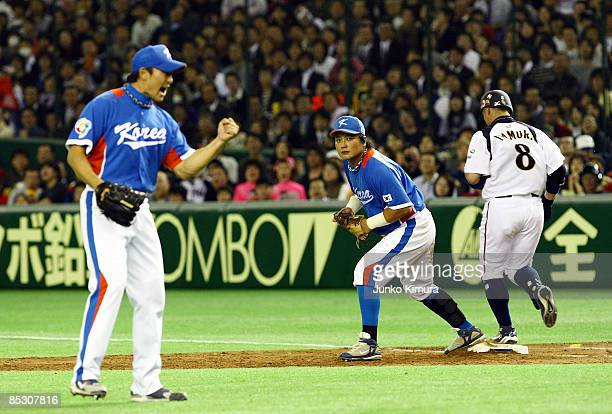 Infielder Akinori Iwamura of Japan is put out in the bottom half of the fifth inning during the World Baseball Classic Pool A Tokyo Round match...