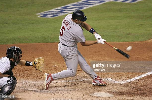 Infielder Albert Pujols of the St. Louis Cardinals hits a 3 run home run against the Houston Astros during the ninth inning of Game Five of the...