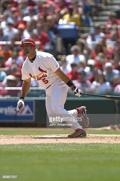 Infielder Albert Pujols of the St Louis Cardinals swings at a Florida Marlins pitch during the game at Busch Stadium on May 15 2004 in St Louis...