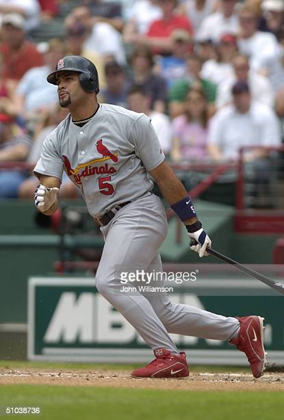 Infielder Albert Pujols of the St Louis Cardinals swings at a Texas Rangers pitch during the interleague game at Ameriquest Field in Arlington on...