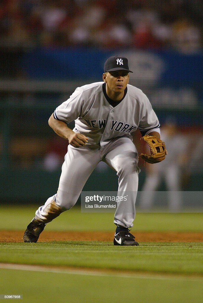 Infielder Alex Rodriguez #13 of the New York Yankees prepares to catch the ball during the game against the Anaheim Angels at Angel Stadium on May 19, 2004 in Anaheim, California. The Yankees won 4-2.