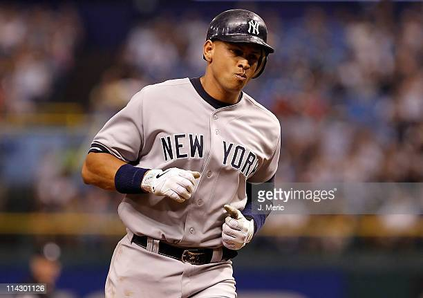Infielder Alex Rodriguez of the New York Yankees rounds the bases after this home run against the Tampa Bay Rays during the game at Tropicana Field...