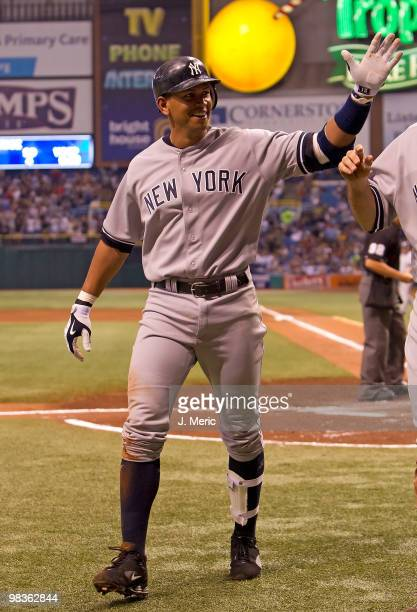 Infielder Alex Rodriguez of the New York Yankees smiles after hitting a triple and scoring on an error against the Tampa Bay Rays during the game at...