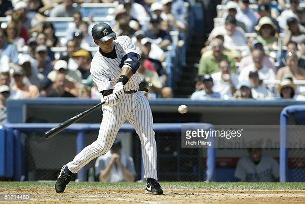Infielder Alex Rodriguez of the New York Yankees swings at a Toronto Blue Jays pitch during the game at Yankee Stadium on August 9 2004 in the Bronx...
