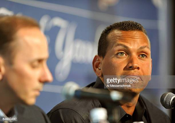 Infielder Alex Rodriguez of the New York Yankees talks during a press conference as General manager Brian Cashman listens February 17, 2008 at the...
