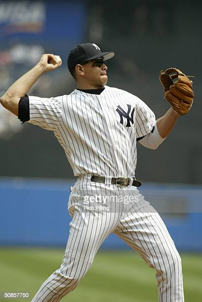 Infielder Alex Rodriguez of the New York Yankees throws the ball against the Anaheim Angels at Yankee Stadium on May 13 2004 in the Bronx New York...