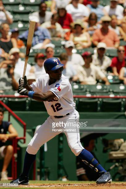 Infielder Alfonso Soriano of the Texas Rangers waits for an Anaheim Angels pitch during the game at Ameriquest Field in Arlington on July 22, 2004 in...