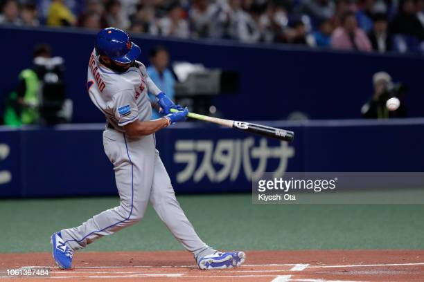 Infielder Amed Rosario of the New York Mets hits a single in the top of 1st inning during the game five between Japan and MLB All Stars at Nagoya...
